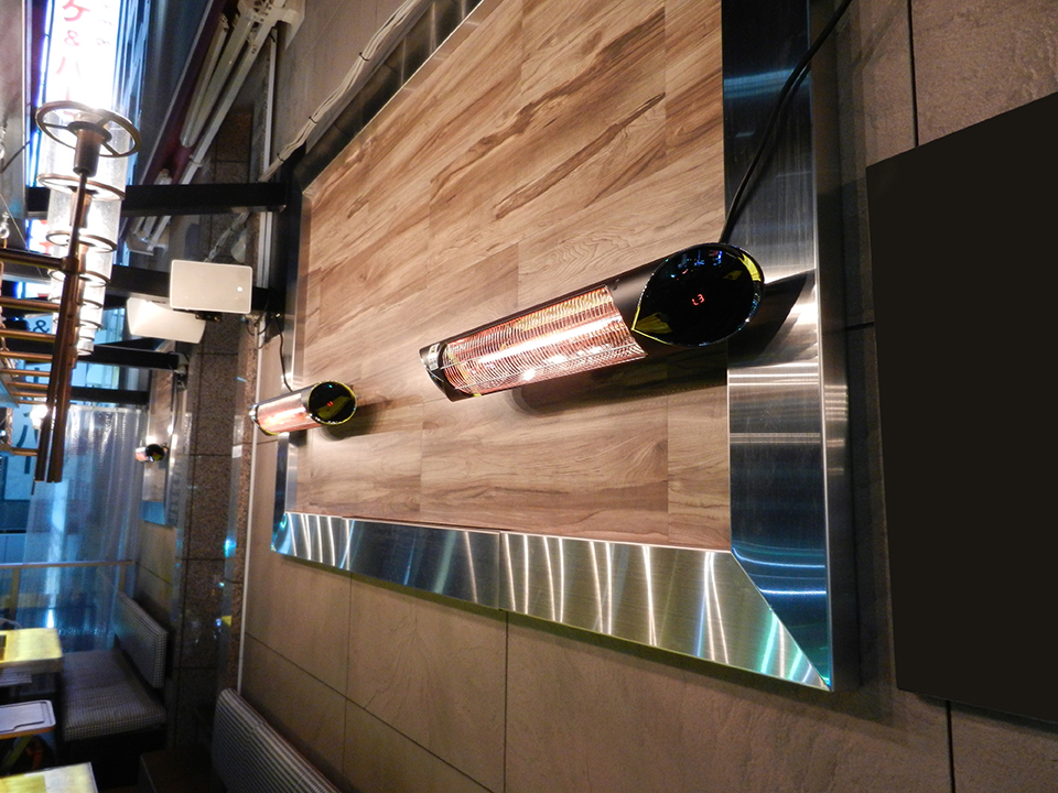 The Infra ER+ 2500W installed on the wall in a restaurant.